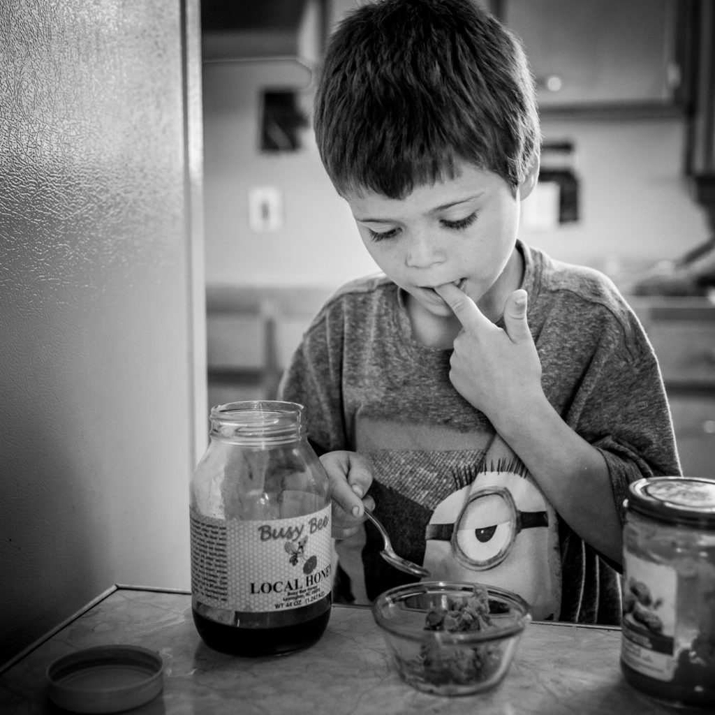 Boy eating peanut butter and jelly