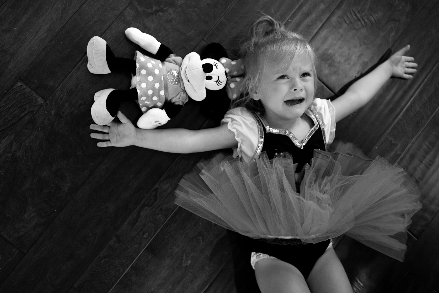 Little girl crying with her minnie mouse doll