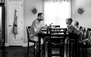 Father and son talking over the breakfast table
